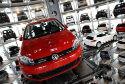 A red Volkswagen Golf car is retrieved by an automated palette from a storage tower near the company's main factory in the northern German city of Wolfsburg on March 12, 2009. Earlier Martin Winterkorn, CEO of German car maker Volkswagen (VW) addressed the company's annual press conference where he expressed the desire for his company to be number one in its sector by 2018.  AFP PHOTO  DDP / NIGEL TREBLIN    GERMANY OUT