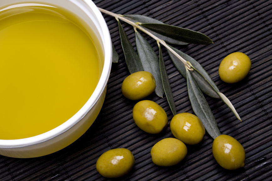 Extra virgin olive oil with green olives